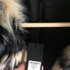 VIRKELIG flot imiteret pels fra Magasin.  Aldrig brugt.