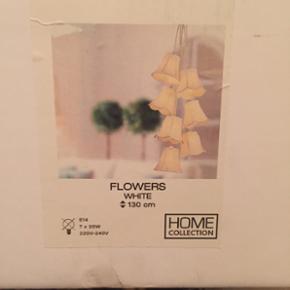 Ilva Flowers loftslampe, har været brugt et års tid virker fint - sælges som den er med pære. Nypris var 1500 kr