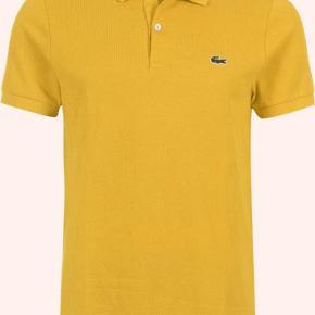 Lacoste live polo i en frisk gul farve, billede nr. 2 for bedste farve gengivelse. Det er en str. 4 = M Mp 200