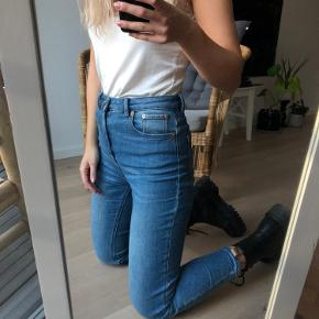 ASOS Farleigh high waist blue mom jeans in W27L30. Worn, but have a lot of wear left, still good condition. Super comfortable and soft!!   I am 168cm, and as you can see they're a liiitle bit short. I normally wore them with boots, which works for me.