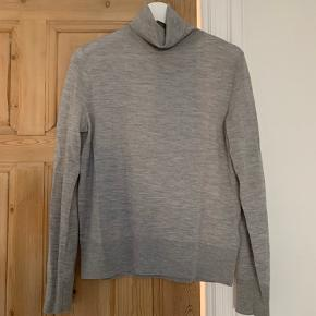 Chic, comfortable COS wool turtleneck / roll neck light grey knitted jumper.   Size S. Worn a few times. Perfect for the chilly months coming up!  100% wool.   The colour of the jumper is closer to the first image included than the images taken from my phone.  Open to serious offers.