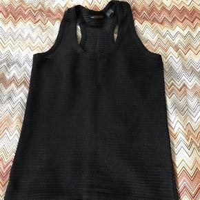 Racer back top with a little shimmer from mango.