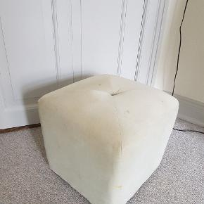 It has a few spots on the cushion but is still nice and fluffy!