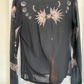 Gennemsigtig trøje med mønster