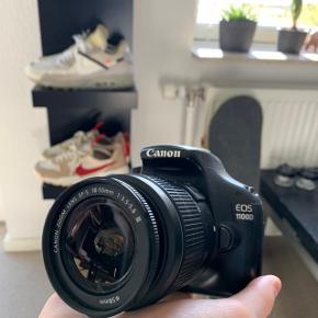Canon Eos 1100D Linsedæksel, oplader og taske medfølger.  Pris: 1299.-  Næsten nyt kamerastativ kan medfølge for en merpris.