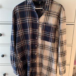 Varetype: Skjorte Størrelse: 10 Farve: Ternet Oprindelig købspris: 300 kr.  Oversize skjorte fra Missguided. Den kan bruges som kjole, men er også fed som en oversize skjorte over et par jeans.  Det er en str. 10, hvilket vil svare til en str S/M.