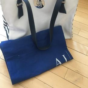 Petrol blue and white practical Armani Jeans bag. Only used 2-3 times. In very good condition.