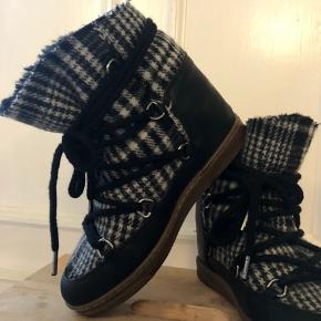 Limited edition.  Isabel Marant - nowles støvle.  Ingen skader, brugt få gange dette efterår. Størrelse 37, - passer både 37 og 38.  Super lækre og varme.