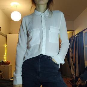 Sheer, white shirt ⚪ Very versatile to style.