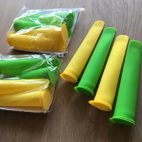 """Isform, hånd-isforme, skub-op-is-form  3 sæt med 4 i hver (to i hver farve). Aldrig brugt. Det ene sæt er blevet åbnet, som det fremgår af billederne, men det har aldrig været brugt.  Købt på coolstuff.dk, hvor de koster 99 kr. per pakke: """"Fakta om KitchPro håndisforme •4 styk i en pakke, 2 gule og 2 grønne •Længde: 20 cm •Diameter (øverst): 4 cm •Fremstillet i levnedsmiddelgodkendt silikone – fri for ftalater, latex og BPA (testet fri for hormonforstyrrende stoffer, afgiver altså ikke noget farligt ved frys/afkøling) •Kan gå i opvaskemaskinen •Med det tætsluttende låg kan du lægge isene hvor som helst i fryseren uden at risikere spild"""" Pris: 50 kr. per sæt, 130 kr. for alle 3 sæt.  Handler helst via. MobilePay. Bytter ikke.  Rabat ved køb af flere af mine varer.  Kan afhentes i postnummer 9541 eller sendes til nærmeste GLS-udleveringssted for 39 kr."""