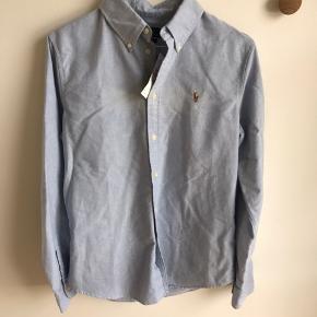 Ralph Lauren skjorte, dame. Custom fit, str. medium. Stadigvæk med prismærke. Nypris 799,-