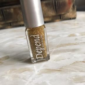 Helt ny guld glitter neglelak fra depend