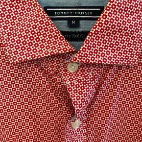 Nice dressy shirt with interesting collar and many details and beautiful pattern. Barely worn, comes in M but fits people who wear both M/L sizes like me.