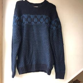 Blue knitted men's Wrangler sweater. Used but looks good.