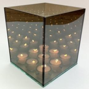 Fineste uendelighedskube m. Plads til 9 fyrfadslys.
