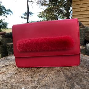 Materials: Fur: Mink Soft calf leather, suede lining, light gold hardware. Dimensions: Centimeters: 26w x 20h x 9d