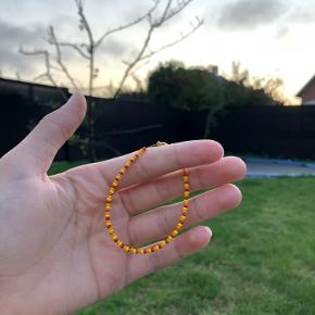 Et flot solnedgangs armbånd med fine detaljer.✨🌅