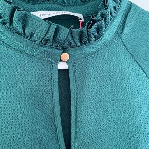 Helt ny, farven er en smule dybere grøn end billedet viser. Nypris 1000 kroner