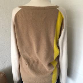 Trøjen er 50% uld og 50% angora