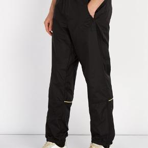 Acne Studios black Nylon Trackpants. Never used, still with pricetag. Original price 1800 kr. Size S but more of a Medium