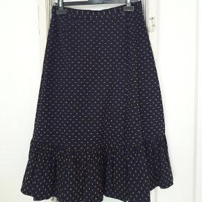 spar 20% nu Smuk, slå om nederdel med orange mønster