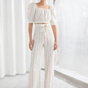 Belted linen blend trousers with vertical stripes, frontal pockets, duo hook and zipper fly  Relaxed and light fit, perfect for the summer or even winter if wearing tights underneath  Never used as they are a bit too long for me