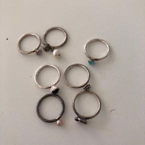 7 ringe i sølv i str xxs Trænger til rens men ellers fine