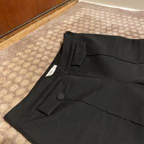 Fine bukser med søde lommer.