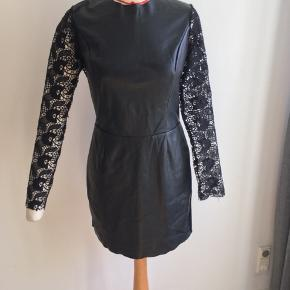 Super flattering pleather and lace dress Side M Only used a few times