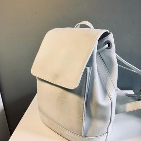 90's Lacoste backpack. It's a relatively small backpack with loads of pockets and easy to use.  Great vintage condition no tear just needs a bit of polishing for the white color to get brighter.