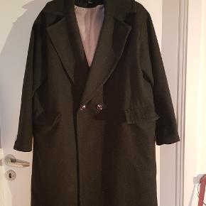 Lækker uld frakke str 42, brugt få gange. Oversize