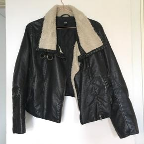 Black faux leather jacket with faux sheep skin collar.