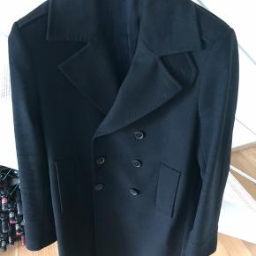Purchased for DKK 4000. Elegant double-breasted coat from SPO Copenhagen, a contemporary brand by Sand Copenhagen. The coat is wool cashmere making it the best quality for a coat, highly comfortable and good for winter.