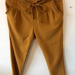 Karry gule bukser Str. L i børnestørrelse som svarer til XS-S