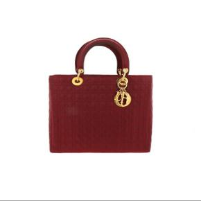 Christian Dior Lady Dior Bag Burgundy fabric, medium size  Condition: excellent  Bag is in excellent conditions overall. Minor signs due usage on the bottom.  Inside clean.  Size: 32 x 24.5 x 9.5 cm  Fancy Lux Rif: 1836