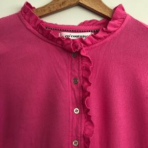 Lyserød skjorte
