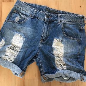 Varetype: Shorts Farve: Denim Prisen angivet er inklusiv forsendelse.