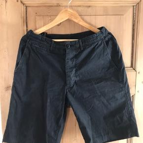 Stone island shorts med badge, lavet fra originale stone island bukser. Kan tilpasses i størrelse, passer 30-34 waist