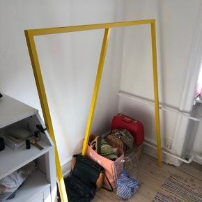 Super nice HAY clothing rack in yellow. Very sturdy. Adds a bright pop of color in any room.  I've had it for a while, it has no damages, just some small marks.