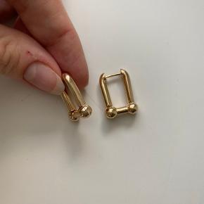 Helt ny forgyld øreringene med 15 k guld. Aldrig brugt, i perfekt stand