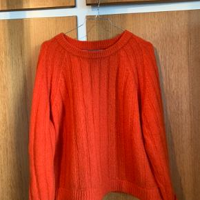 Dejlig varm strik, blanding mellem orange og rød