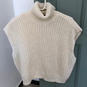 Kortærmet strikket turtleneck i uld fra ASOS.