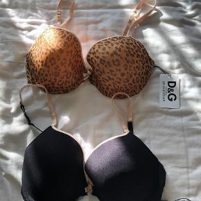 Varetype: BH Størrelse: 80D Farve: Leopard,Sort Oprindelig købspris: 900 kr.  D & G bh i sort eller leopard. Str. 80 D - aldrig brugt. Ny pris pr. Stk 450 kr.  Bytter ikke - mp. 225 pr. Stk. Pp. Via mobilpay. Begge samlet for 400 kr
