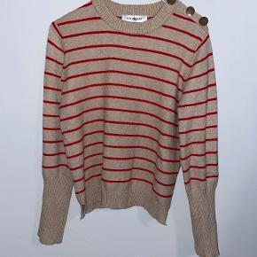 Continue sweater