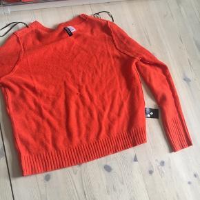 Orange strik fra h&m   Max brugt to gange