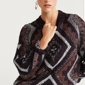 Thick knitted fabric.Fabric with metallic thread.Diamond jacquard.High collar.Long sleeve.Dropped shoulder seams.