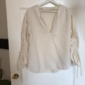 Very Jacquemus inspired blouse with ruched sleeves and strings.  It has been worn so has minor damages as pictured  Says 38 on the label but will better suite size 36