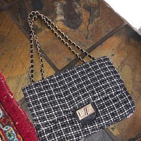Ligner en Chanel taske - mp er 150
