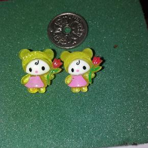 Øreringe  - piger Mønten er en 1 kr for at vise str. Kan sendes med postnord som brev for 10 kr. Eller med dao for 32 kr.