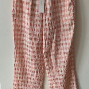 Bukser fra Neo Noir. Str. Small.  Style : Zena check.  Aldrig brugt.